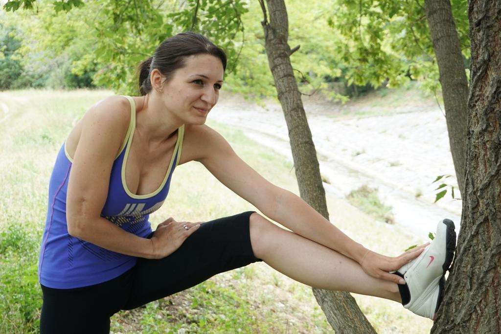 Frau dehnen Sport Jogging Laufen